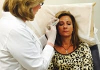 Dr. Stetler injecting Mommy blogger with botox