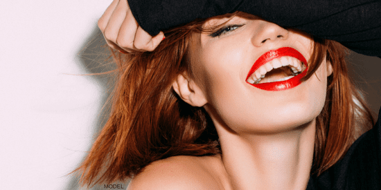 Model smiling with red red lipstick