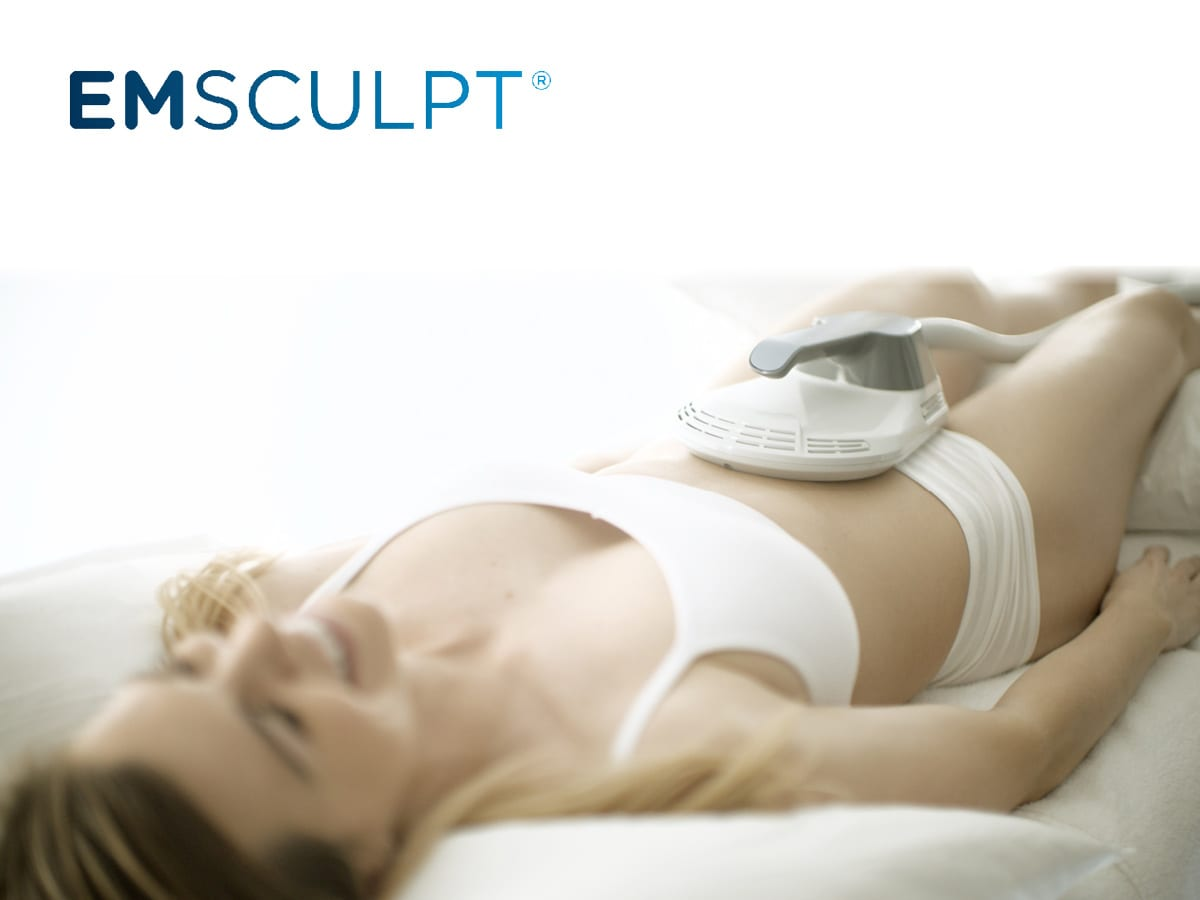 Woman receiving an EMSCULPT treatment on her stomach