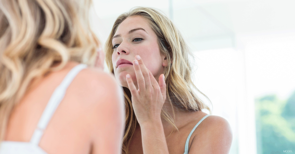 Woman in Dallas, TX considering medical dermatology options to treat acne